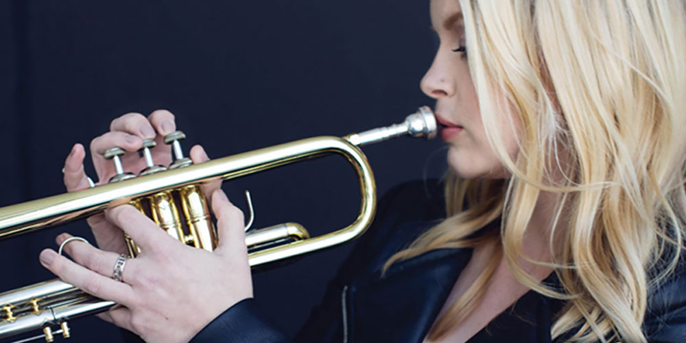 Bria Skonberg playing the trumpet