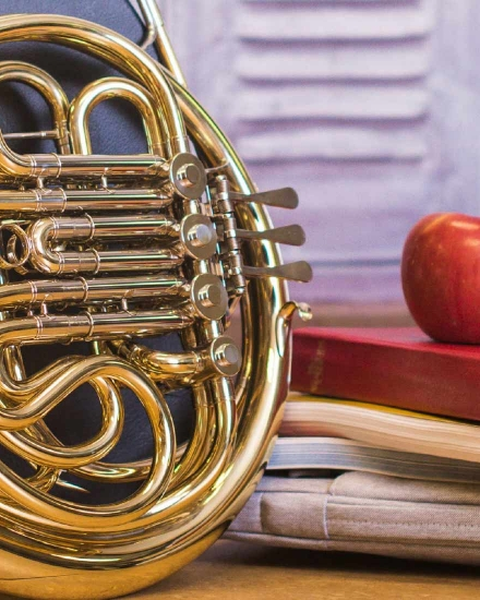 French Horn with School Books